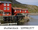 Traditional old fishing port on Lofoten Islands in Norway - stock photo