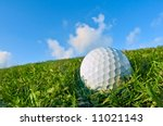 golf ball on fairway bunker with blue sky background - stock photo
