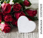 red roses and heart shape with copy space - stock photo