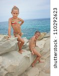 Girls on the rocks - stock photo