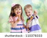 Children with ice cream cone outdoor - stock photo