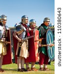 FORT GEORGE, SCOTLAND - AUGUST 11: Unidentified actors in Roman costume entertain the crowds at the annual Celebration Of The Centuries event on August 11, 2012 at Fort George, Scotland. - stock photo