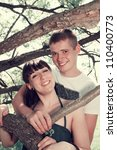 Romantic couple hugging in the woods under a tree - stock photo
