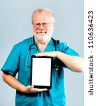 Doctor holding tablet vertically with white place for your text - stock photo