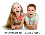 Smiling children lying on the white floor - stock photo