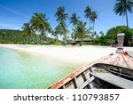 Beach and palms from long tail boat - thai paradise - stock photo