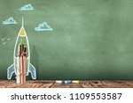 Back to School Concept with Hand Drawn Rocket on Blackboard - stock photo
