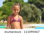 Girl by the swimming pool - stock photo