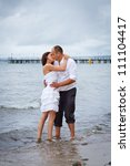 Portrait of married couple at the sea scenery - stock photo