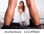 Bride shocked at the groom striptease - stock photo