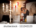Romantic kiss of married couple - stock photo