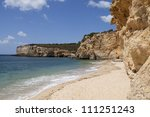 View of a beautiful and desert beach in Algarve - Portugal - stock photo