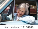 Happy senior out driving the old car - stock photo
