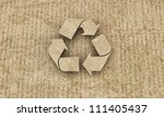 recycle symbol on cardboard - stock photo