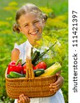 Vegetable garden - lovely girl with the basket of ecological harvests - stock photo