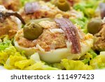 closeup of a plate with delicious stuffed eggs - stock photo