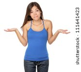 Shrugging woman in doubt doing shrug showing open palms. - stock photo