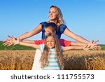Woman and kids soaking in the sun on a late summer afternoon - stock photo