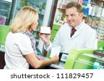 pharmacist suggesting medical drug to buyer in pharmacy drugstore - stock photo