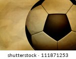 Vintage soccer ball on paper grunge background - stock photo