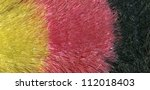 abstract background of colorful interleaved translucent plastic fibers - stock photo