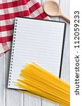 the blank recipe book with italian spaghetti - stock photo