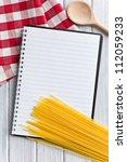 the blank recipe book with italian spaghetti - stock photo