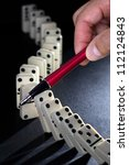 Stop the domino effect concept for solution to a problem - stock photo