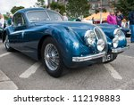 GRANTOWN ON SPEY, SCOTLAND - SEPTEMBER 2: Jaguar XK120 coupe on display in the annual Motor Mania car show on September 2, 2012 in Grantown On Spey, Scotland - stock photo