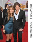 "LOS ANGELES, CA - APRIL 2, 2009: Miley Cyrus & father Billy Ray Cyrus at the world premiere of their new movie ""Hannah Montana The Movie"" at the El Capitan Theatre, Hollywood. - stock photo"
