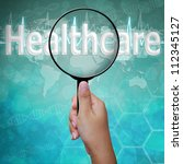 Healthcare, word in Magnifying glass , background medical - stock photo