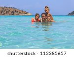 Family in the sea - stock photo