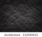 Black rough wall background - stock photo