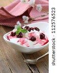 dairy dessert with sweet  sauce and cherries - stock photo