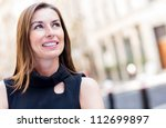 Portrait of a thoughtful business woman smiling - stock photo
