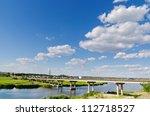 bridge over river and blue sky - stock photo