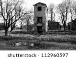 ruined old house in woodland black and white - stock photo