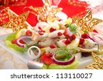 herring salad with apple,cranberry,lemon and dill for christmas - stock photo