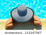 Woman in swimming pool resting - stock photo