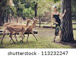 Blonde beauty with deers - stock photo