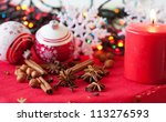 Variation of spices, Christmas decorations and a candle - stock photo
