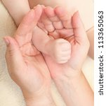Funny picture of mothers and baby hands. - stock photo