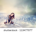 Happy Young Woman Sitting on the Clouds - stock photo