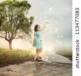 Little Girl at a Shining Brook with Stars - stock photo