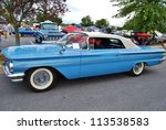 FREDERICK, MD- SEPTEMBER 16: Unidentified man drives a 1960 Blue Pontiac Catalina on September, 2012 in Frederick , MD USA. Alzheimer's Association Car Show at Motor Vehicle Administration in Maryland - stock photo