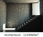 Interior room with concrete walls and stairs leading to the exit - stock photo