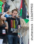 London, United Kingdom, 13th July 2018: Journalist Owen Jones, speaks at an anti Trump Rally in central London - stock photo