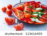 Salad with tomato and mozzarella on plate - stock photo