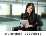 Asian Business woman using Digital Tablet at work. - stock photo