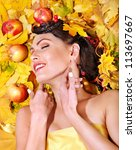 Woman holding autumn apple and leaves. - stock photo